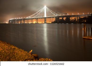 View of the Bay Bridge lit up at night, San Francisco, North Beach, California, USA