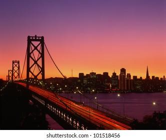 View of Bay Bridge from Treasure Island at sunset, San Francisco, California