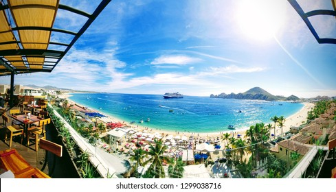 A view of the bay at Cabo San Lucas, Mexico. Sunny bright sky's with a cruise ship popping out in the center.