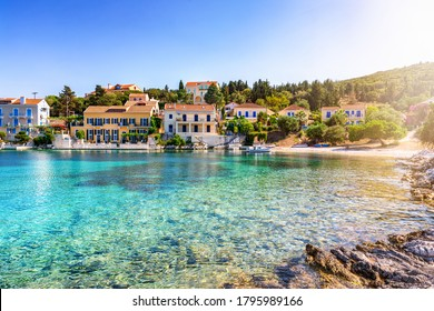 View to the bay of Fiscardo town, the cosmopolitan village and sailors paradise at the north side of Kefalonia island, Greece, with turquoise sea and colorful houses