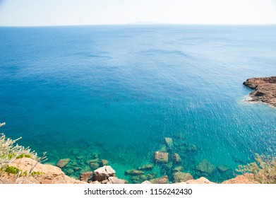 View of a bay off Cape Sounion in Athens riviera, blue pristine water of Aegean sea