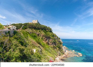 View of the bay and old fortress on a rock, Tuscany, Italy.