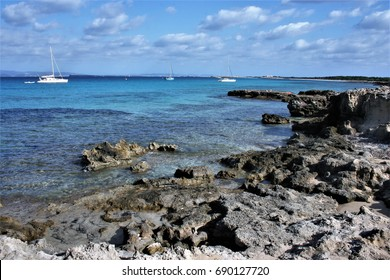 View of bay with white yachts,Formentera, Balearic Islands, blue sea,Mediterranean sea, favorite destination of foreign tourists in Spain