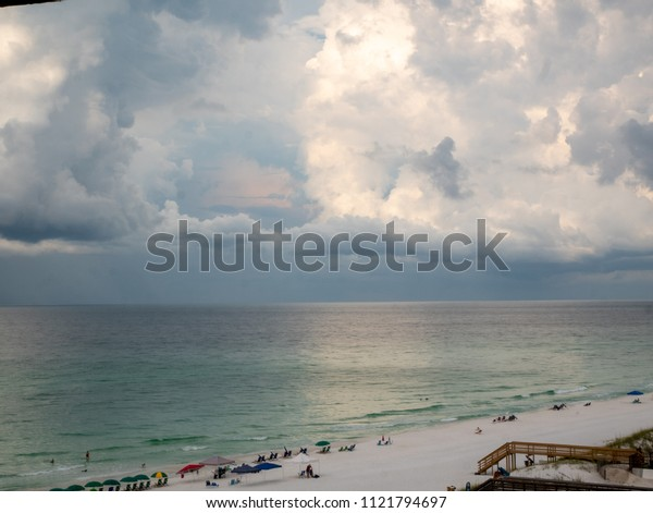 View of Beach With Calm Ocean with Storm Coming