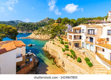 View of beach and holiday apartments in Fornells village, Costa Brava, Spain
