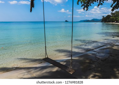 view of the beach at Chang Island, Trat Province, Nice wood cradle among shadow of the tree and beautiful beach on summer hot day.