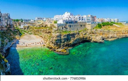 View of the beach lama monachile cala porto in the italian city polignano a mare.