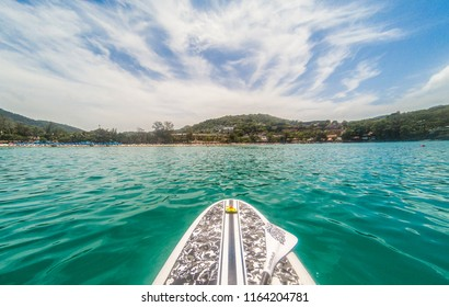 View to the beach and mountains from the emerald color sea and SUP (stand up paddle)