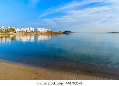 A view of beach in Naoussa village at sunrise time, Paros island, Cyclades, Greece