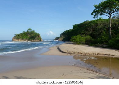 view of the beach at the north side of Playa Pelada near Nosara in Costa Rica taken in the early morning