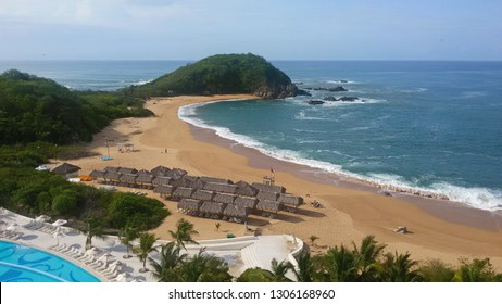 View of the beach and ocean bay from the Secrets Huatulco Resort in Huatulco Mexico