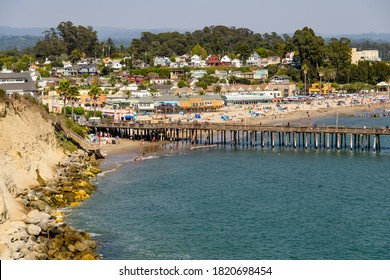 View of the beach and pier at Capitola. People relaxing on the beach after quarantine. Life after the coronavirus pandemic.