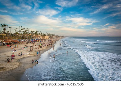 View of the beach from the pier at sunset, in Oceanside, California.