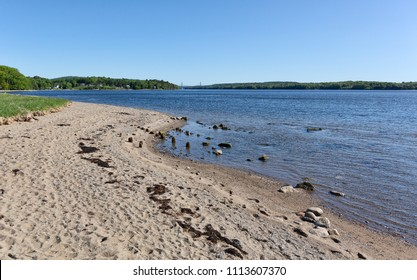 View of the beach at Sandy Point Beach Park in Stockton Springs, Maine on a bright sunny morning.