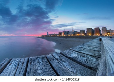 View of the beach and sea of Jesolo at the last lights of the sunset,taken February 27, 2019.