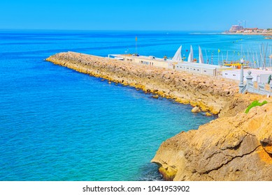 View of the beach and the sea shore of a small resort town Sitges in the suburbs of Barcelona.