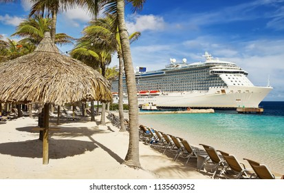 View from beach at tropical resort on cruise ship docked at port