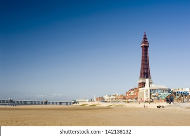 View of the beachfront at Blackpool along the golden sands to the pier and Blackpool Tower