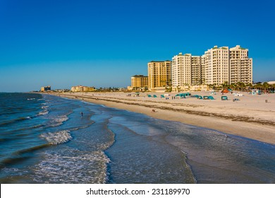 View of beachfront hotels and the beach from the fishing pier in Clearwater Beach, Florida.