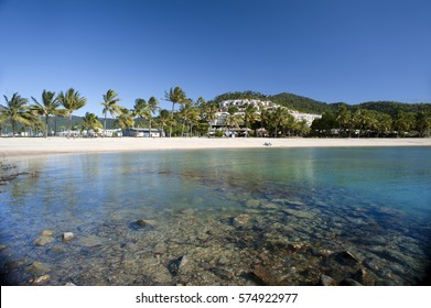 View of beautiful Airlie Beach, Queensland, Australia with its white sands fringed by tropical palms on a sunny summer day in a travel concept