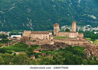 View of beautiful ancient city of Bellinzona in Switzerland with Castelgrande castle from Montebello