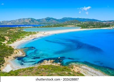 View of a beautiful bay with azure sea  from top of a hill, Villasimius, Sardinia island, Italy