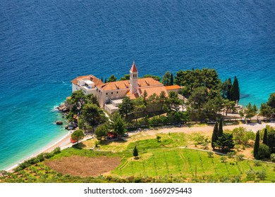 View of beautiful bay with beach and Dominican monastery in Bol town, Brac island, Croatia. Dominican monastery in Bol, built in 15th century. Bol town, Brac island, Croatia.