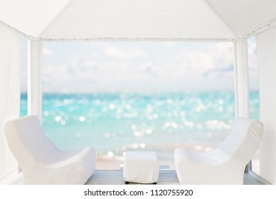View of the beautiful beach through a Balinese bed. White sandy beach of a luxury resort in Punta Cana, Dominican Republic.