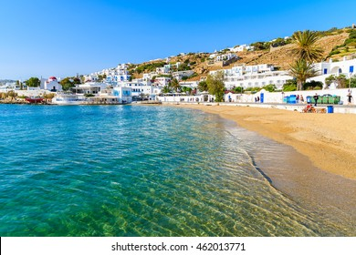 View of beautiful beach with turquoise sea water in Mykonos port, Mykonos island, Greece