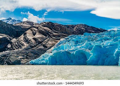 View of the beautiful Blue Iceberg of Glacier Grey on Lake Grey with Rock mountain at Torres del Paine National Park in Southern Chilean Patagonia Ice Field