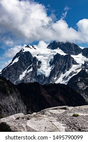 View of the beautiful blue skies, white clouds, and snow on Mount Shuksan Whatcom County Washington, USA