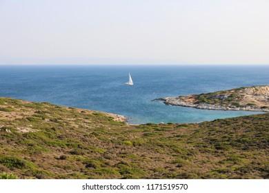 View of the beautiful blue and turquoise Aegean Sea of Aquarium Beach (Mermer Burnu) on the island Bozcaada in Turkey.
