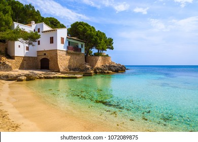 View of beautiful Cala Gat bay with beach and house on shore, Majorca island, Spain