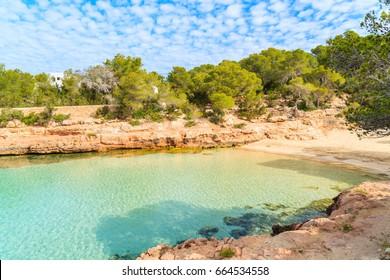 View of beautiful Cala Gracioneta beach and bay at early morning, Ibiza island, Spain