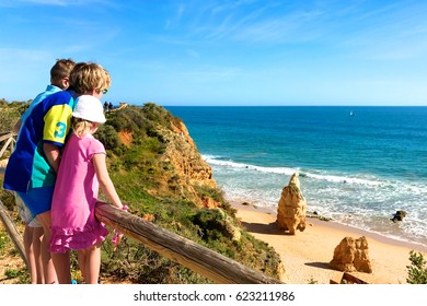 View from the beautiful cliffs above Praia dos Tres Castelos to the west of Praia da Rocha in south Portugal. Children hiking and enjoying one of most spectacular places in Portimao, Algarve region.