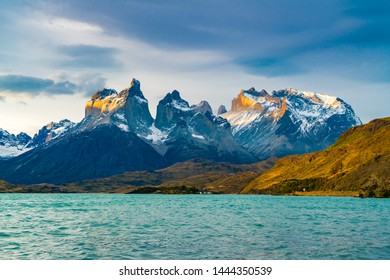 View of beautiful Cuernos del Paine Mountains and Lake Pehoe in Torres del Paine National Park in the evening, Chile