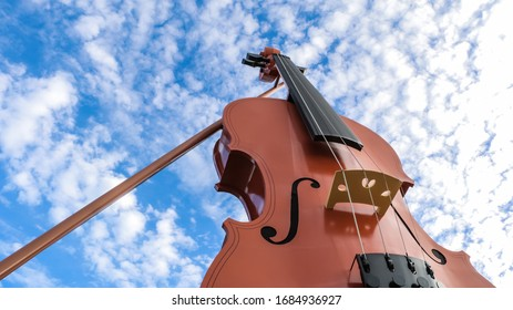 View of beautiful fiddle with blue sky and clouds as background.
