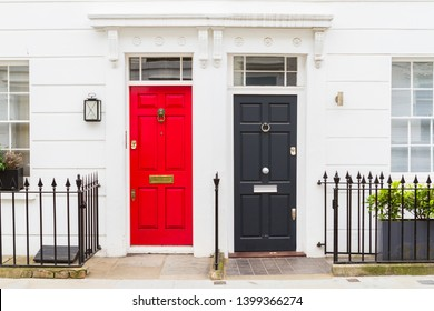 View of beautiful front doors of two neighbouring english town houses on a London Street.