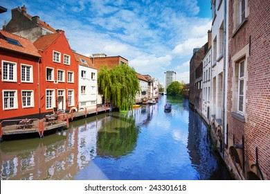 View of beautiful Ghent in Flemish region, Belgium on Leie river during summer time with waterfront houses in downtown