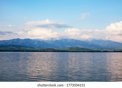 View of a beautiful lake with snowy Tatras in the background.