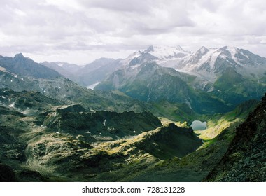 View of beautiful landscape in the Alps with snow-capped mountain tops.