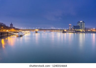 View of the beautiful long River Rhine, illuminated Ships and the City of Cologne in the Evening in Germany Cologne 2018.