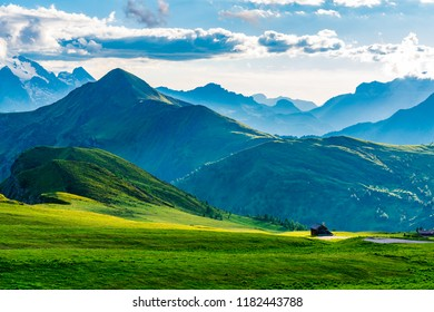 View of the beautiful mountain in the evening with Italian cottage in the evening light at Giau Pass in Belluno Italy