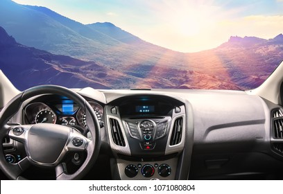 view of the beautiful mountain scenery from the car through the windshield