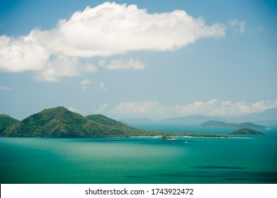 View of beautiful nature of Dunk Island in sunny day with bright white cloud over sea and forest covered hills - Queensland, Australia