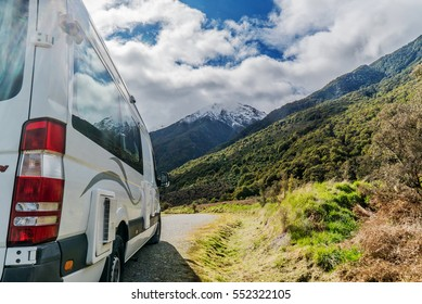 view of the beautiful New Zealand mountains next to a Camper van