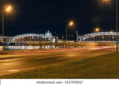 view of the beautiful Peter the Great Bridge and Smolny Cathedral in St. Petersburg against the night sky