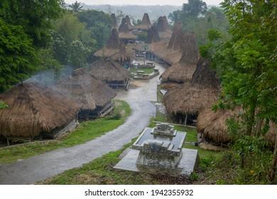 View of beautiful Prai Ijing traditional village on a rainy overcast day, Waikabubak, Sumba island, East Nusa Tenggara, Indonesia