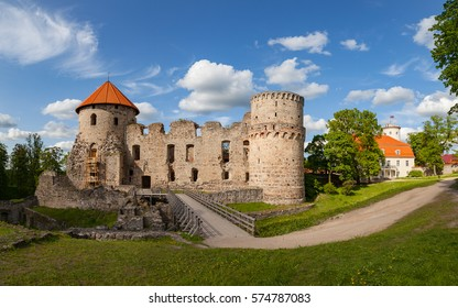 View of beautiful ruins of ancient Livonian castle in old town of Cesis, Latvia. Greenery and summer daytime.