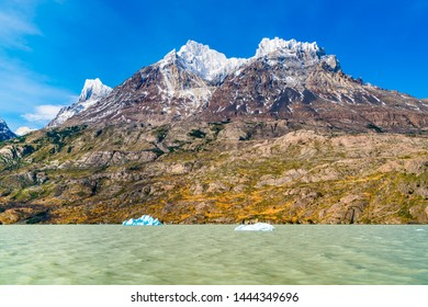 View of the beautiful snow mountain with Iceberg break off the Grey Glacier floating in Grey Lake at Torres del Paine National Park in Chile